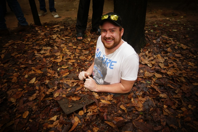 Justin in the Cu Chi Tunnels